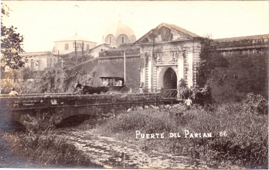 Vintage view of a calesa (horse carriage) exiting the Parian Gate, Walled City of Manila.