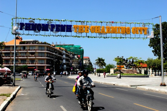 "View down Sisowath Quay, proclaiming Phnom Penh's (utterly convincing) creds as a ""Charming City""."