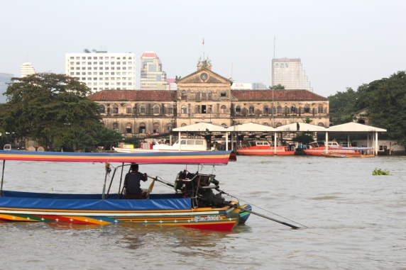 The Chao Phraya River today with the former Customs House in the background.