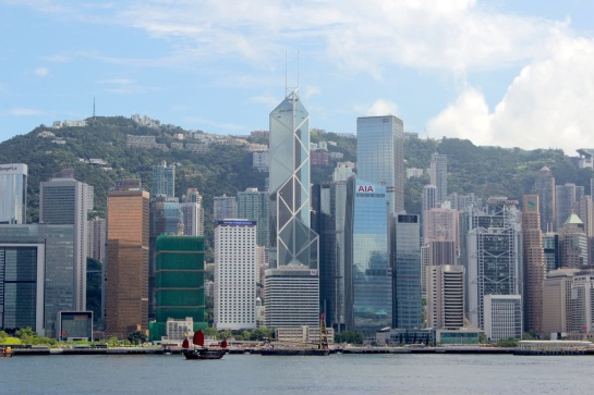 The Hong Kong skyline today, and the lone junk still plying the waters of the harbour.