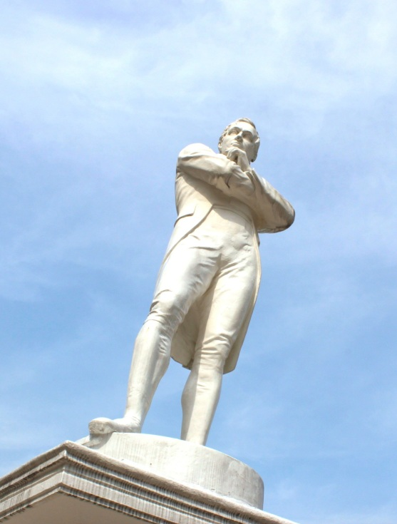 Statue of Sir Thomas Stamford Raffles, at his purported landing site, along the Singapore River.