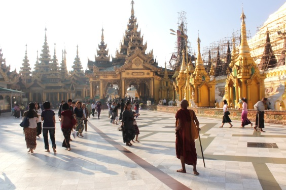 Lone monk amidst the visiting worshippers, Shwedagon Pagoda.