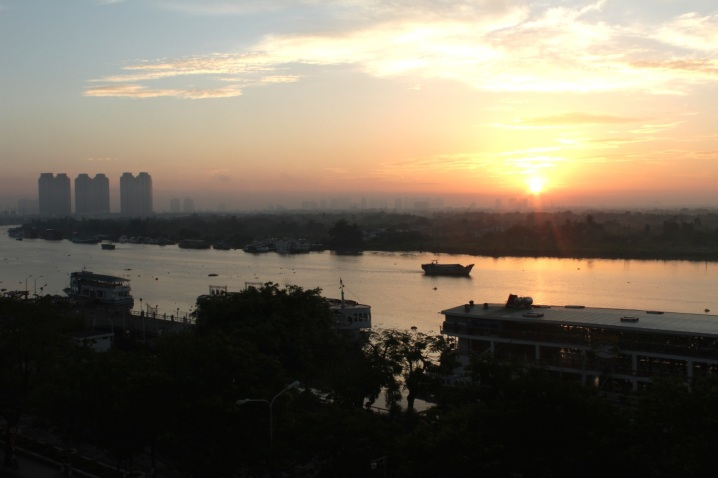 Dawn over the Saigon River - view from my balcony at the Hotel Majestic.