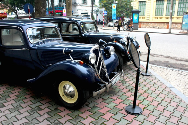 Vintage Citroens at the Sofitel Legend Metropole Hotel.